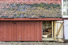 Rustic weathered wood storage shed with open door, roof shingles stock image