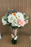 Rustic wedding bouquet contain pink rose and other flowers with Royalty Free Stock Photos