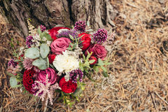 Rustic wedding bouquet of red rose Stock Photos