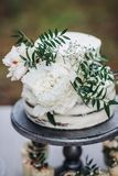 Rustic Wedding Cake with White Peonies royalty free stock images