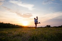 Rustic wedding couple at sunset in the summer outdoors stock photo