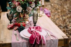 Rustic wedding decoration for festive table with beautiful flower composition. Autumn wedding. Artwork. Rustic wedding decoration for festive table with royalty free stock photos