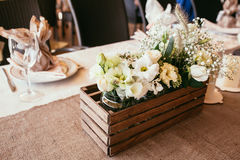 Rustic wedding decorations. wooden box with bouquet of flowers o Stock Images