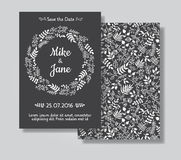 Rustic wedding invitation card set. White floral wreath on black chalkboard background. Save the date and invitation card Royalty Free Stock Photography