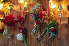 Rustic wedding photo zone. Hand made wedding decorations includes Photo Booth  red flowers. Royalty Free Stock Image