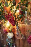 Rustic wedding photo zone. Hand made wedding decorations includes Photo Booth  red flowers. Stock Images
