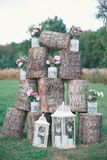 Rustic wedding photo zone. Hand made wedding decorations includes Photo Booth, wooden barrels and boxes, lanterns, suitcases and. White flowers Stock Photos