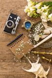 Rustic wedding planning and photography concept. Notepad, seashells and vintage camera. Rustic wedding planning and photography concept. Top view shot of notepad royalty free stock photography