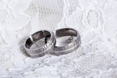 Rustic wedding rings on white lace Royalty Free Stock Photo