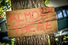 Rustic wedding sign with writing. Homemade rustic wedding sign that says `Almost There stock photos