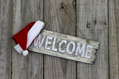 Rustic welcome sign with Christmas Santa Claus hat Royalty Free Stock Images