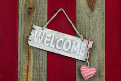 Rustic welcome sign with hanging heart stock photography