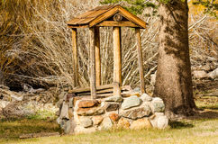 Rustic Well. Wood and stone well on historic site of Hayden Log Cabin in Mammoth Lakes, California Royalty Free Stock Photography