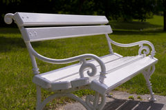 Rustic white bench in park close up Royalty Free Stock Photos