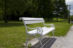 Rustic white bench in park Royalty Free Stock Images