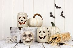 Rustic white Halloween decor. Still life against a white wood background Stock Images