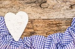 Rustic Fathers Day greeting card with heart and blue fabric border on old wood background royalty free stock images