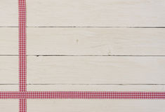 Rustic white wood boards with checkered tape Royalty Free Stock Photo