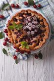 Rustic whole cherry pie vertical top view Stock Photo