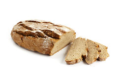 Rustic whole wheat bread and slices Stock Images