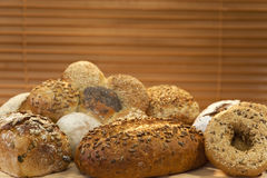 Rustic Wholemeal & Seeded Handmade Bread Loaves. A selection of rustic, wholemeal and seeded handmade breads shot in golden sunlight Royalty Free Stock Photos