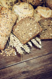 Rustic  wholemeal sliced bread and pastries Stock Photography