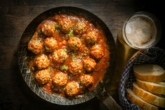 Rustic wholesome lunch of meatballs and beer Royalty Free Stock Images