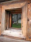 Rustic window. House reflexion in window Stock Image