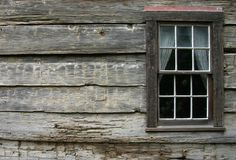 Rustic Window 2. A very rustic window on an old mountain cabin royalty free stock photo