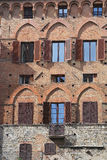 Rustic window in a brick wall in Siena Royalty Free Stock Photography