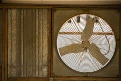 Rustic Window fan. In an old garage Stock Photo