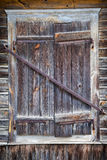 Rustic window of old wooden house Stock Photography