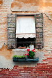 Rustic window with shutters in old venice house Stock Images