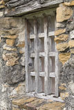 Rustic Window in a Stone Wall. One of the rustic wooden windows placed in a stone wall at one of the missions of San Antonio, Texas stock photography