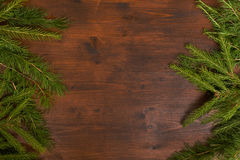 Rustic winter background with larch and fir branches. Flat lay chrismas rpattern, larch and fir branches  on the wood desk. emty space for text Stock Photo