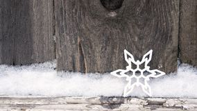 Rustic winter Christmas background with snowflake on wooden texture. Christmas and New Year greeting card background royalty free stock photo