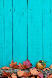 Rustic wood background with autumn leaves and log border Royalty Free Stock Images