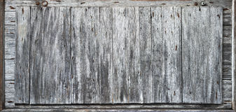Rustic Wood Background Banner. A panel of weathered grey wood with rusty nails and bolts Royalty Free Stock Photo