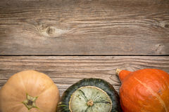Rustic wood background with winter squash Stock Images