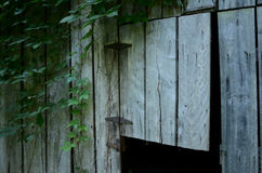 Rustic wood barn details rusty hinges. Vintage and weathered barnwood and rusty hinges on doors in rural Indiana Stock Image
