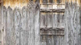Rustic wood barn wall with shutters background stock photo