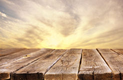 Rustic wood board in front of sky with clouds royalty free stock photo