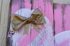 Rustic Wood and Bow. Rustic wood background with a gold bow. Great for use on creative or arts and crafts websites and blogs Royalty Free Stock Photo