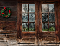 Rustic wood doors. Doors of a rustic wood cabin with christmas wreath Stock Photography