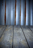 Rustic Wood And Iron Background. A rustic background made of wood flooring and rusted corrugated iron Royalty Free Stock Image