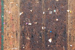 Rustic wood panel background with torn pieces of paper and staples Royalty Free Stock Photo