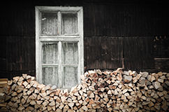 Rustic wood pile. Image of hand choped wood pile next to a rustic romanian house Royalty Free Stock Photo