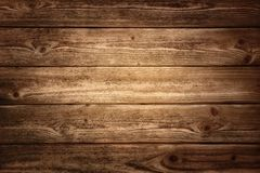 Rustic wood planks background. With nice studio lighting and elegant vignetting to draw the attention Royalty Free Stock Images