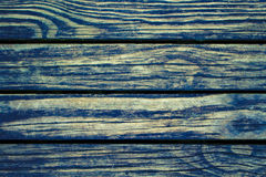 Rustic wood planks closeup. Rough lumber surface. Blue toned wooden background for vintage card. Stock Photos