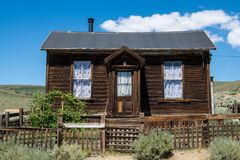 Abandoned, rustic wood-sided home in the ghost town of Bodie in California stock image
